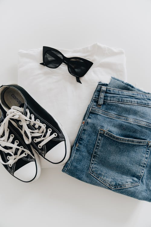 Blue Denim Jeans Beside Black and White Converse All Star High Top Sneakers