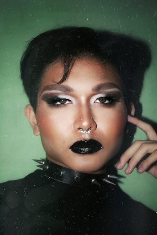 Informal ethnic woman with dark makeup wearing spiked choker