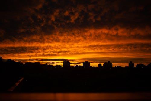 Evening cityscape under majestic sunset sky