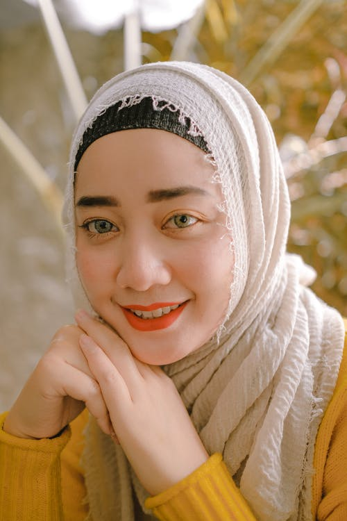 Smiling Woman in White Hijab