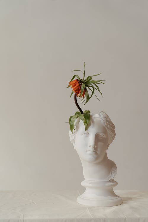 White Ceramic Woman With Orange Flower on Head Bust
