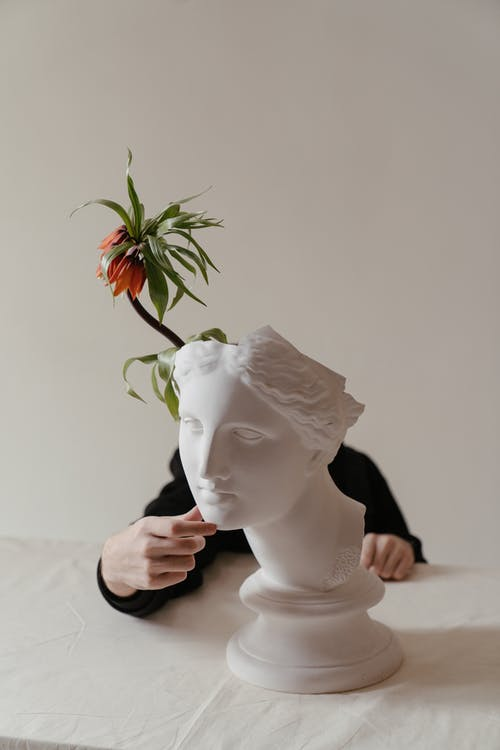 White Rose on Womans Face Ceramic Figurine