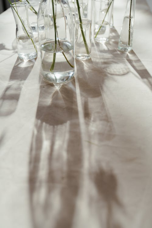 Photo of Clear Glass Vases on White Surface
