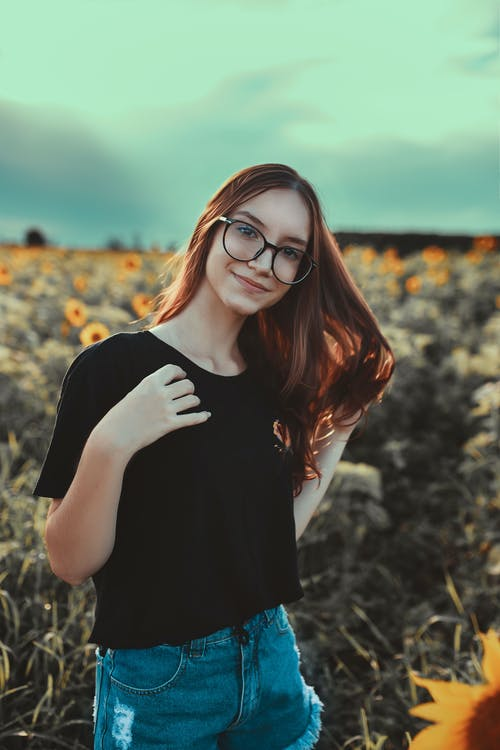 Woman in Black Shirt Wearing Black Framed Eyeglasses