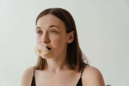 Woman in Black Tank Top With White Pacifier