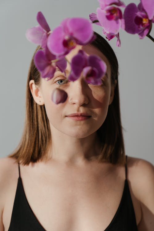 Woman With Purple Flower on Her Head