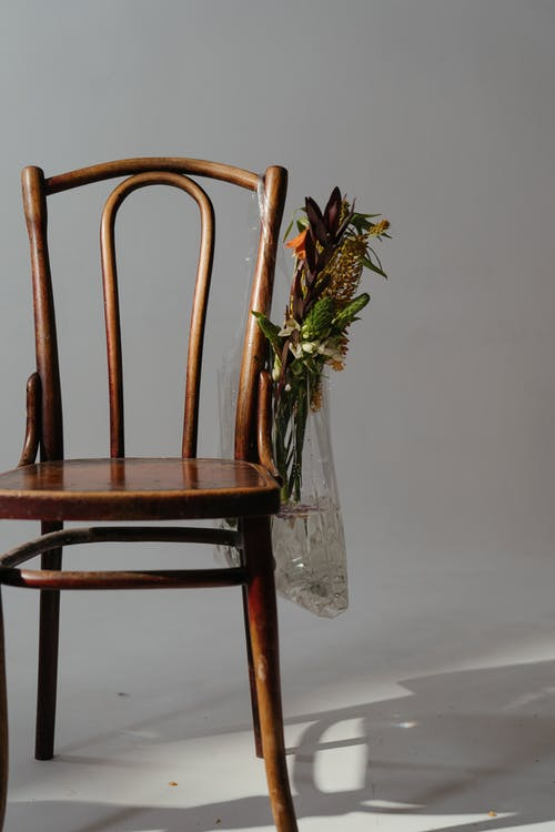 Brown Wooden Chair on White Floor