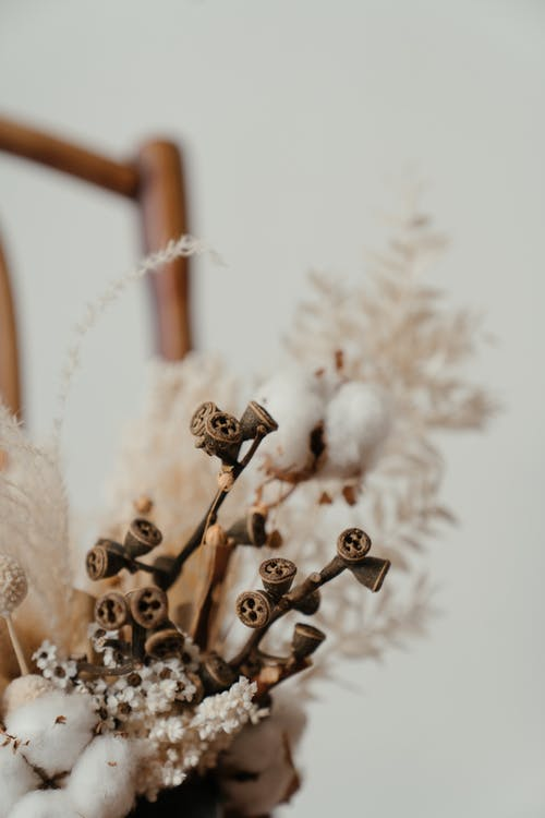 Brown Wooden Cross With White Flowers