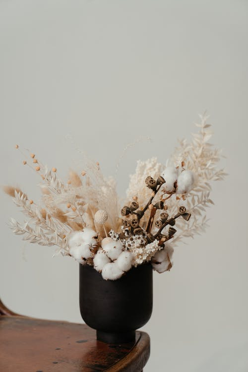 White Flowers in Black Vase
