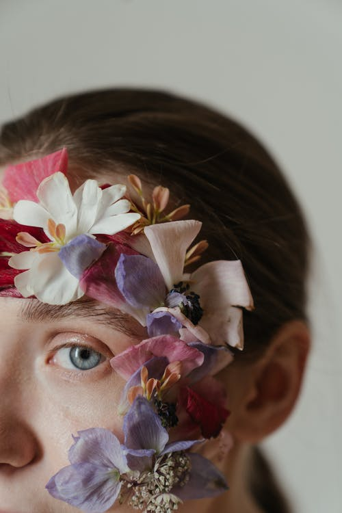 Woman With White and Purple Flower on Her Head