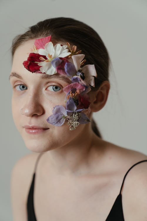 Woman With White and Pink Flower on Her Face
