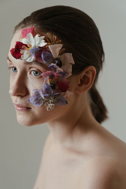 Woman With White and Red Flower Headdress
