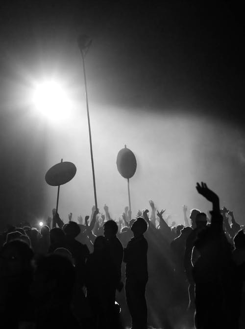 Silhouette of People Standing and Raising Hands