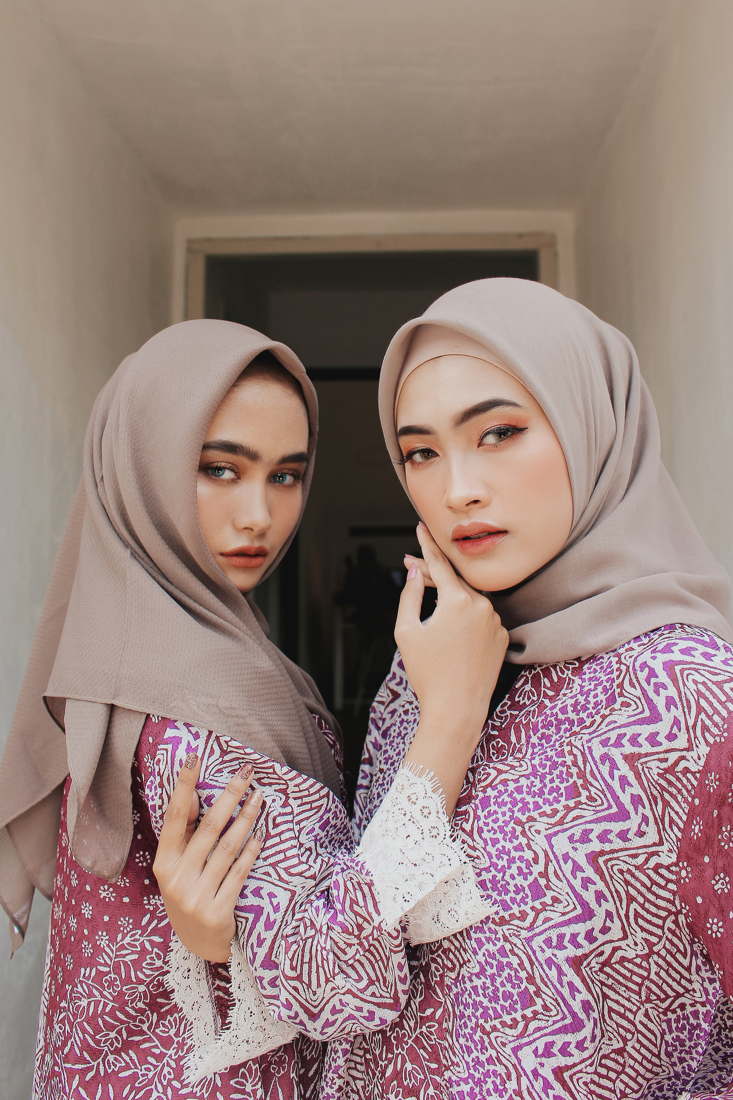 photo of women wearing brown hijab