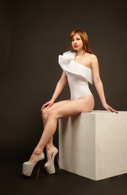 Sensual woman in bodysuit and high heels