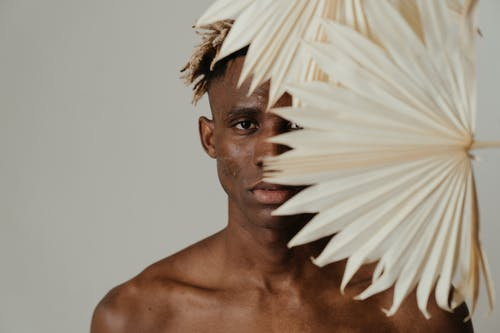 Topless Man With White Feather on His Head