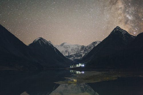 Silhouette Photo of Mountains Under Starry Sky