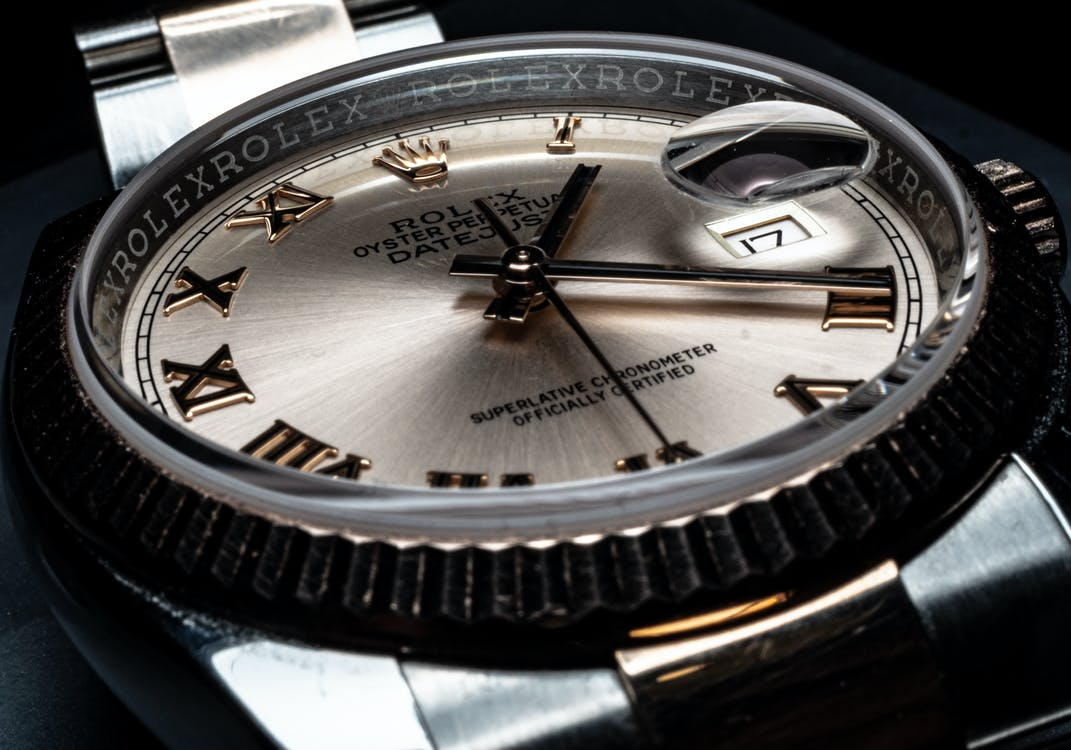 Close-Up Photo of Round Analog Watch