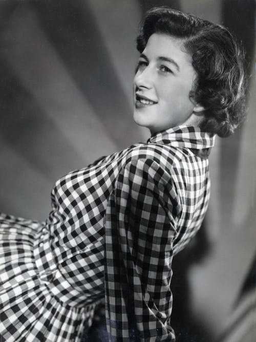Woman in White and Black Checkered Dress