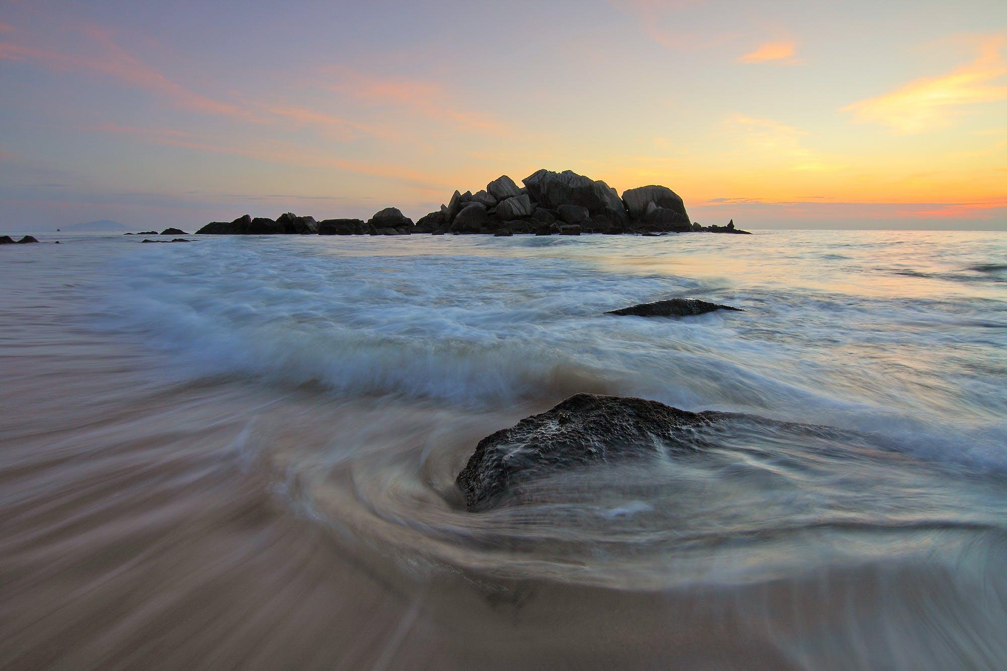 Gratis arkivbilde med bølger, daggry, fredelig, hav