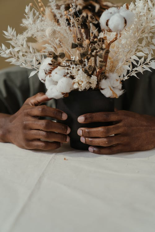 Person Holding White and Brown Flower Bouquet