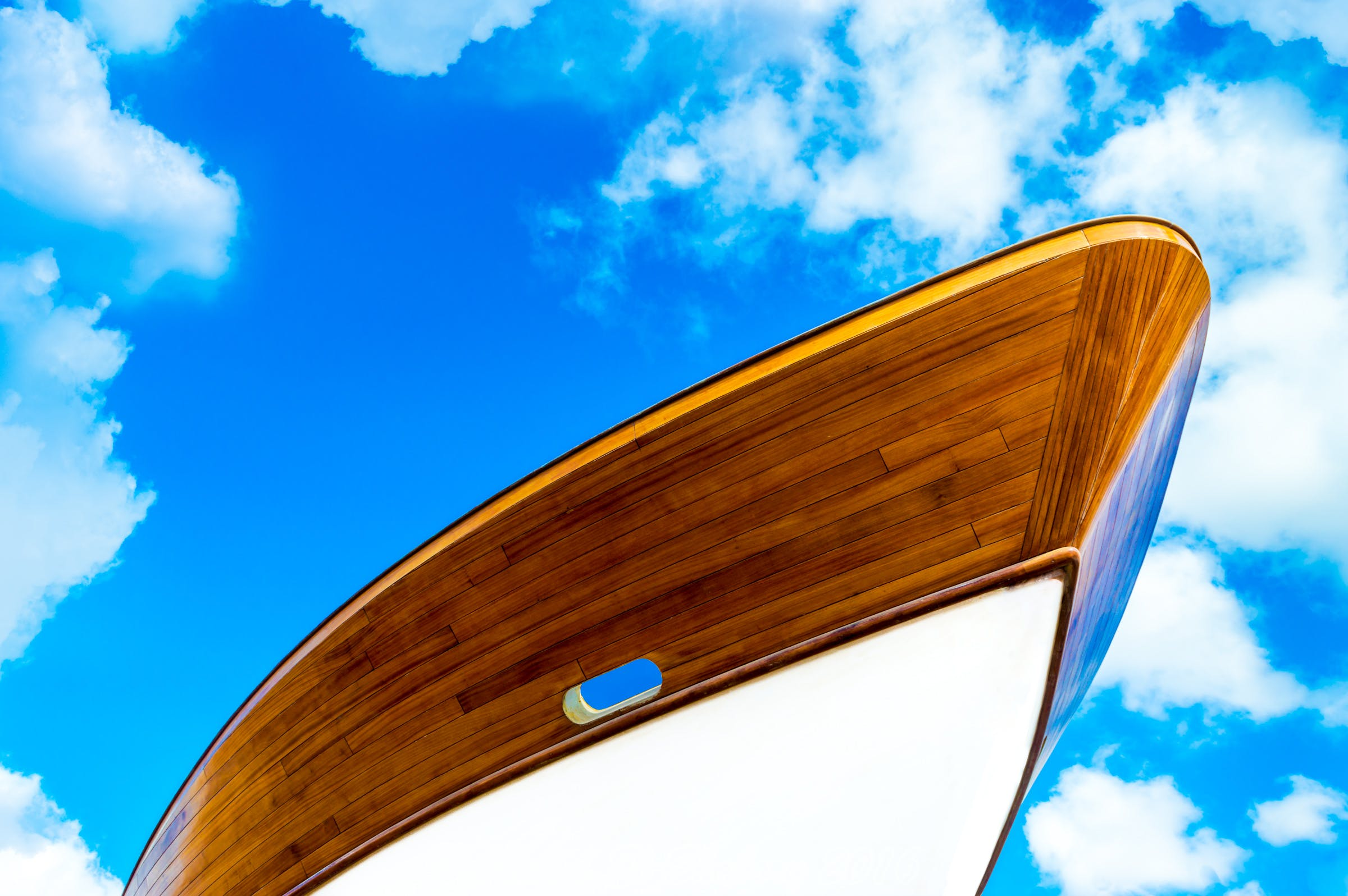Low-angle Photography of White and Brown Boat Under Cloudy Sky