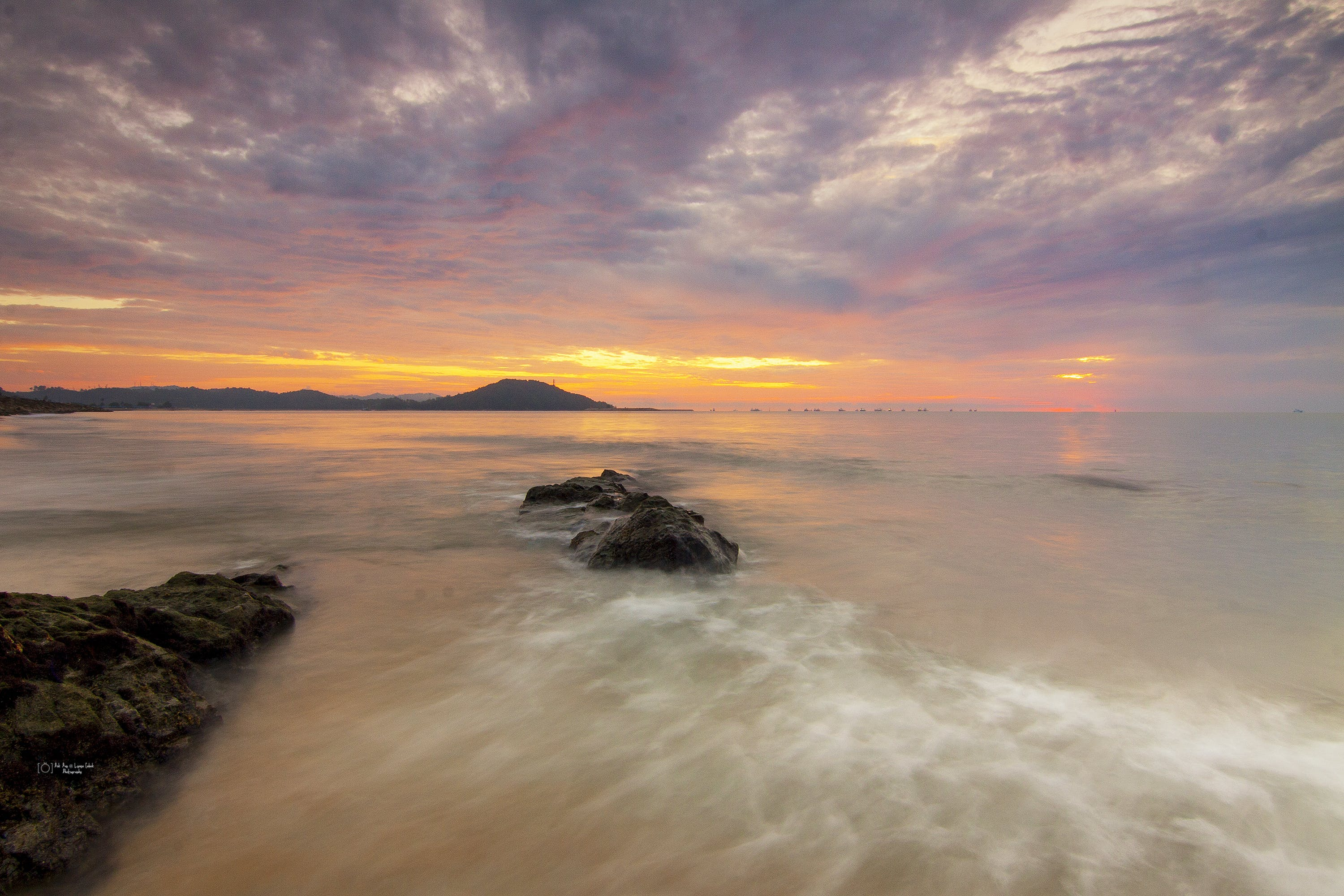 Time-lapse Photograph of Seashore during Golden Hour