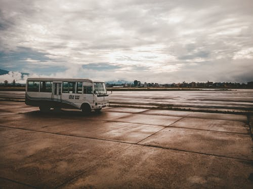 Free stock photo of airport, bus, bus in airport