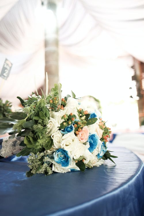 Blue and White Flowers Bouquet on Table