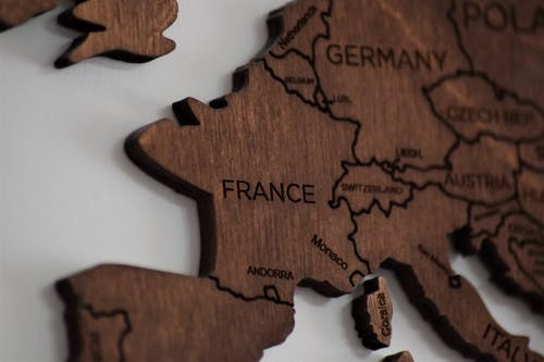 Close-Up Photo of Wooden Jigsaw Map