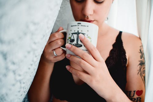 Woman Holding White Ceramic Mug