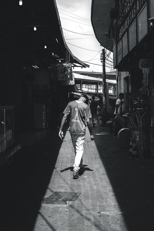 Man Walking on Street