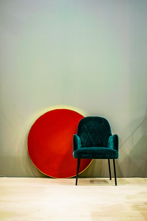 Elegant chair and red circle in room