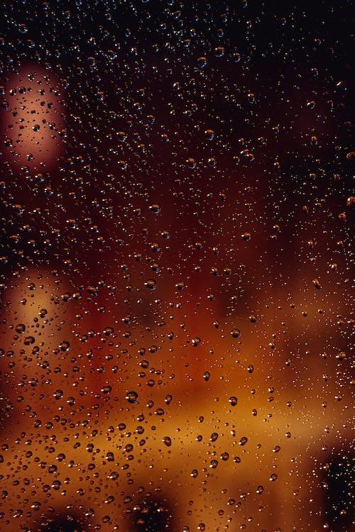 Rain drops on glass at night