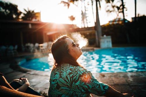 Photo of Woman Wearing Floral Shirt While Smoking