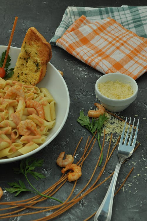 Pasta Dish on White Ceramic Bowl Beside Stainless Steel Fork