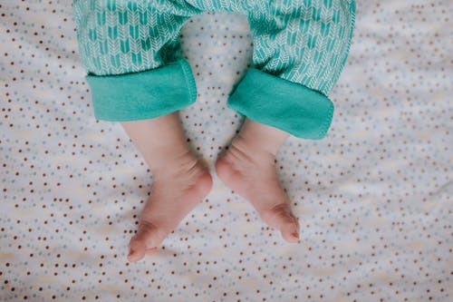 Baby in Green and White Polka Dot Pants