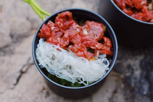 Bowl with rice noodles and meat