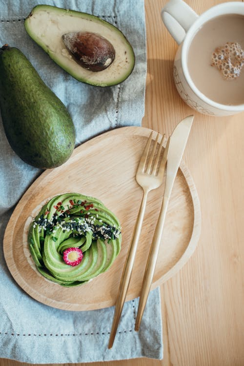 Sliced Avocado Fruit on Brown Wooden Chopping Board