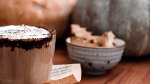 White and Brown Ceramic Cup With Ice Cream