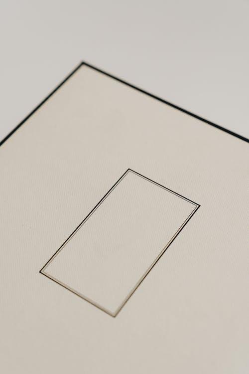Square beige carton present box on light gray background