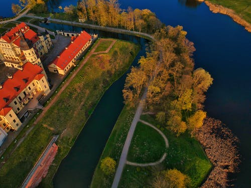 Drone view of medieval castle surrounded by river