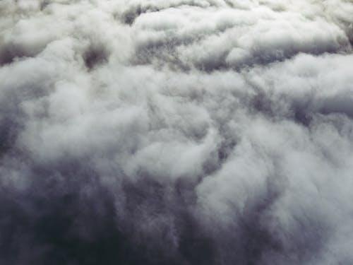 White dense clouds floating over highlands