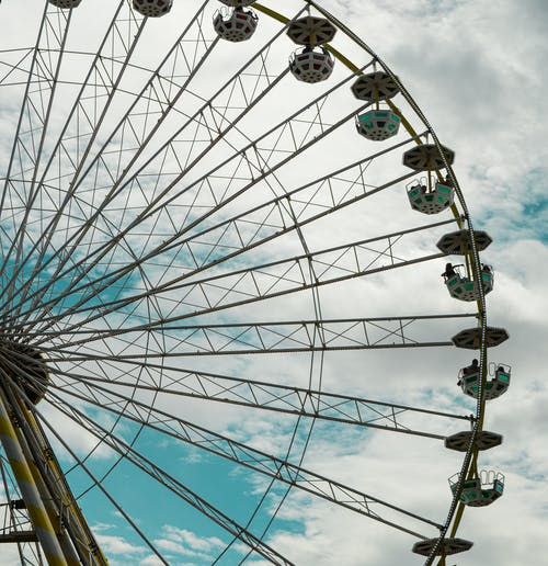 Green and White Ferris Wheel Under Blue Sky