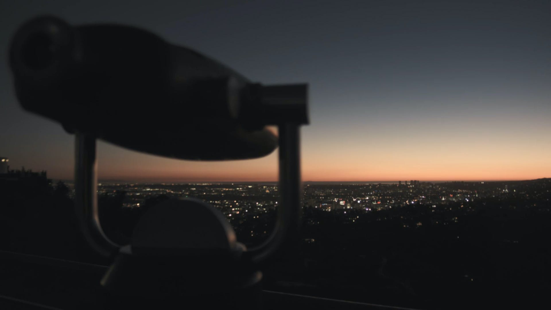 Tower Telescope in Front of Cityscape