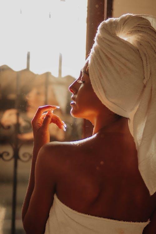 Sensual woman with towel at home