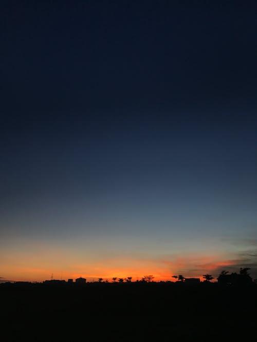Dark sunset sky above countryside