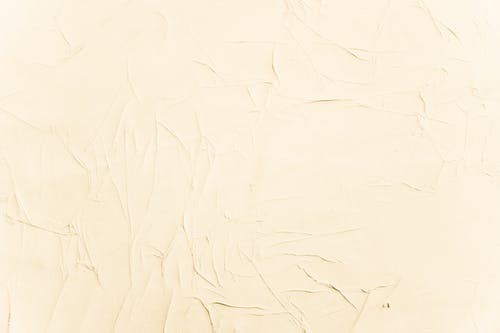 Abstract minimal backdrop with wall decorated with textured stucco in light beige color