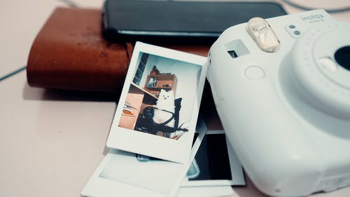 Instant camera and photo placed on desk