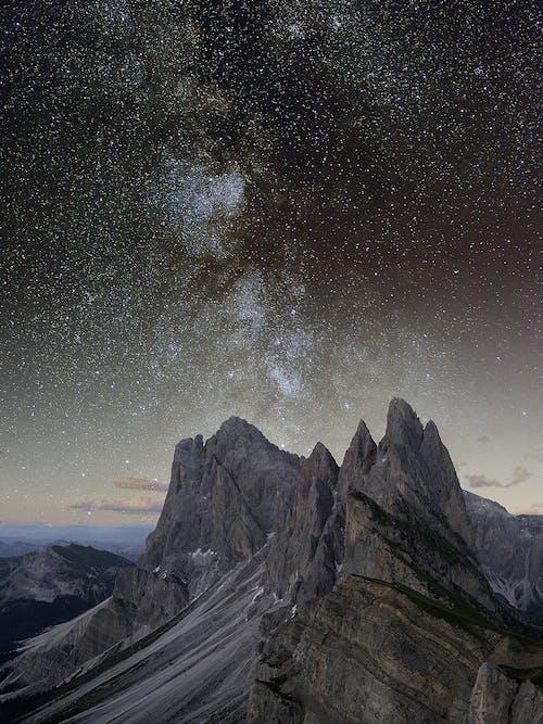 Gray Rocky Mountain Under Starry Night
